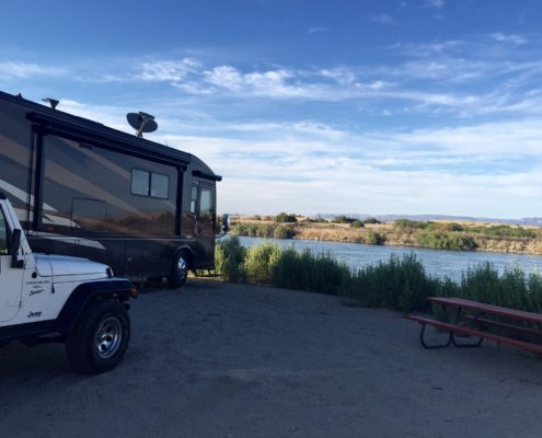Motorhome and Jeep parked along the Colorado River